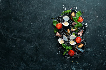 Pasta with seafood. Black paste. Seafood. Top view. Free copy space.