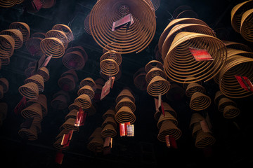 traditional  burning incense coils inside chinese a-ma temple in macau