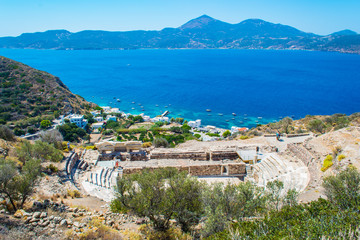 View of the ancient roman theater (3rd BC) and the bay of Klima village in Milos island in Greece