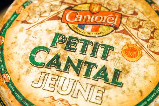 Detail of Petit cantal jeune cheese. Cantal cheese jeune is a type of firm cheese produced in the Auvergne region of central France, aged 1-2 months.