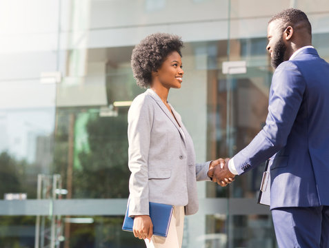 Nice to meet you. Two african business people introducing outdoors