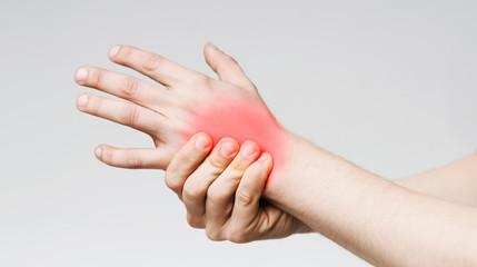 Man massaging sore zone on palm, closeup