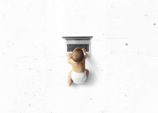 Little cute kid looking at laptop, education concept