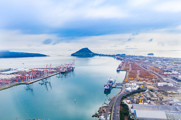 Aerial photography Tauranga Harbour and port with wharf, ships and storage facility.