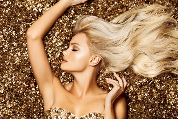 Beautiful hair Girl. Healthy Long Hair. Blonde woman in golden flowers garden, princes Wall mural