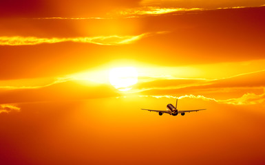 Plane is taking off at sunset