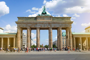 People on street at Brandenburger Tor on summer day in Berlin, Germany
