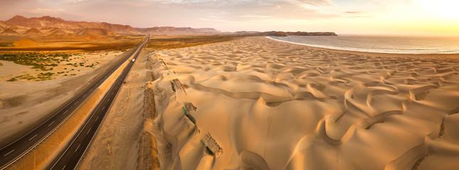 Aerial view of sand dunes in the Peruvian desert at side of the Panamericana international roadway in Ancash, Peru Fototapete