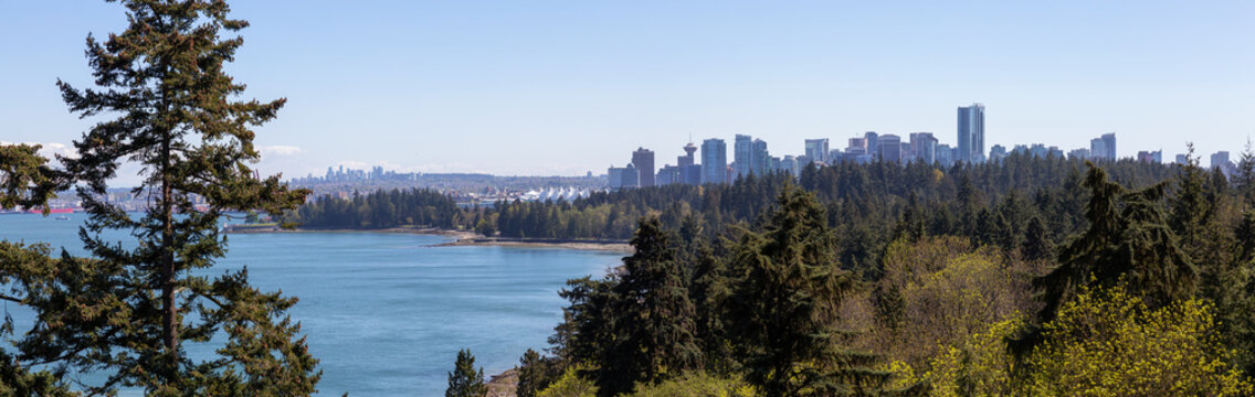 Aerial panoramic view of Stanley Park and Downtown City during a vibrant sunny day. Taken from Lions Gate Bridge, Vancouver, British Columbia, Canada.
