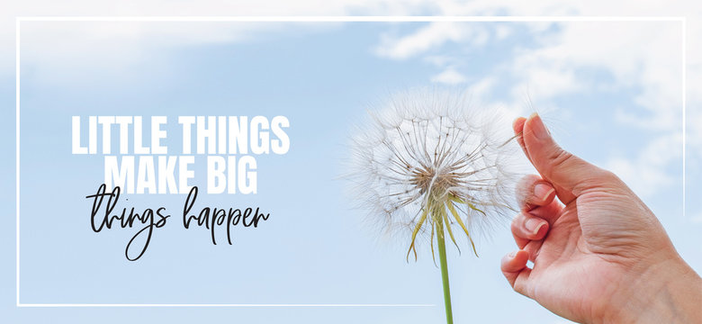Little things make big things happen. Hand holding Dandelion flower pointing to blue sky, close up photography, banner design, poster design. Positive, motivational, inspirational life quotes