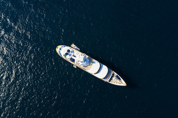 Wall Mural - View from above, stunning aerial view of a luxury yacht sailing on a blue sea. Emerald Coast (Costa Smeralda) Sardinia, Italy.