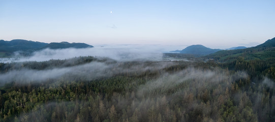 Aerial Panoramic View of Canadian Landscape covered in clouds during a vibrant summer sunrise. Taken near Port Renfrew, Vancouver Island, British Columbia, Canada.