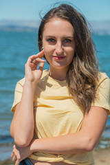 Brunette in yellow by the bay