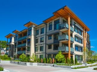 Brand new apartment building on sunny day in British Columbia, Canada. Wall mural
