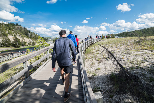 Tourists take a walk on geysers in Yellowstone National Park