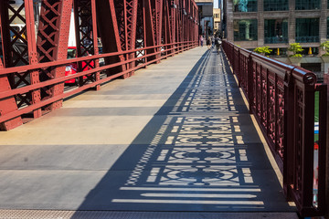 Shadows of the bridge railing design on Wells Street drawbridge in downtown Chicago Loop