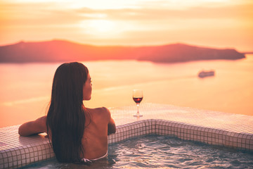 Wall Mural - Santorini hot tub jacuzzi pool woman - wellness spa concept in luxury retreat - high end fancy lifestyle honeymoon destination.
