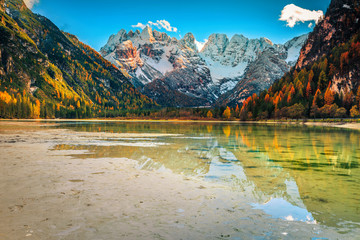 Wall Mural - Amazing alpine lake with snowy mountains in background, Dolomites, Italy