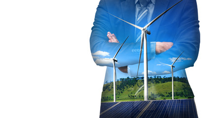 Double exposure graphic of business people working over wind turbine farm and green renewable...