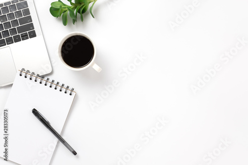 Wall mural Flay lay, Top view office table desk with smartphone, keyboard, coffee, pencil, leaves with copy space background.