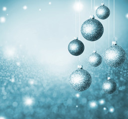 Christmas abstract background with blue glistening balls.