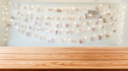 Wood table in blurry background of modern restaurant room or coffee shop with empty copy space on...