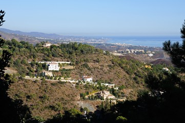 Elevated view across the mountains towards the Mediterranean sea, El Madronal, Andalusia, Spain.