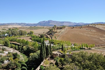 Elevated view across farmland towards the mountains, Ronda, Andalusia, Spain.