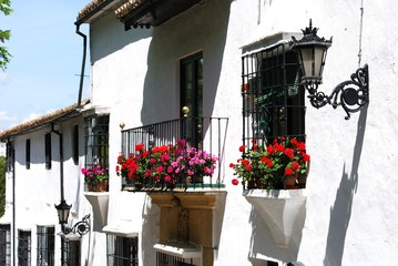 White townhouses with pretty balconies in the old town, Ronda, Andalusia, Spain.