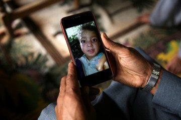Mobile phone displaying picture of a boy who was killed after a cluster bomb that looked like a toy exploded in his hands at home in village Jabri, in Neelum Valley