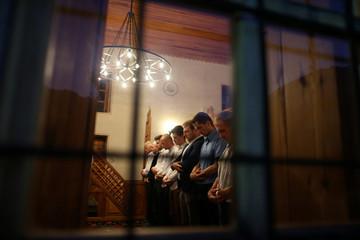 Bosnian Muslims attend a prayer during the Muslim festival Eid al-Adha at a mosque in Kraljeva Sutjeska