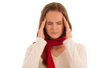 Beautiful young brunette woman holds her head as she has headache - illness