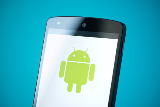 Kiev, Ukraine - September 24, 2014: Close-up shot of Google Nexus 5 smartphone, powered by Android 4.4 version, with Android logotype on a screen.