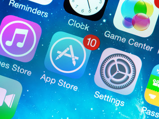 KIEV, UKRAINE - JUNE 12, 2014: A close-up photo of Apple iPhone 5s start screen with various application icons, includes App Store, Settings, Clock, Game Center and others.