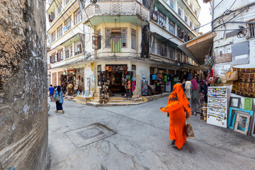 Foto auf AluDibond Sansibar corner street scene in the city of stone town zanzibar town full of life and activity