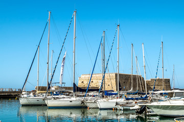 View of the fortress and ships in the port of Heraklion in Crete