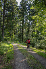 nice and ever young senior woman with her electric mountain bike in the northern Black Forest, Baden-Wuerttemberg, Germany