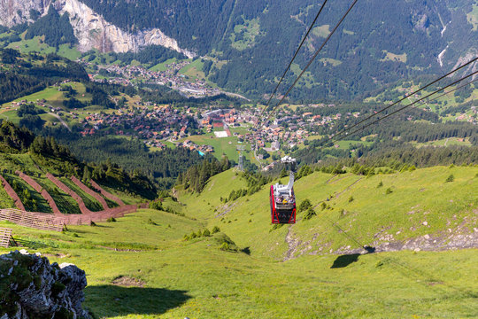 Cable car between the top of Manlichen Mountain and the village Wengen. Switzerland.