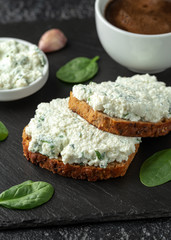 Ricotta cheese spinach sandwich with coffee. healthy breakfast