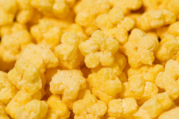 crispy stars - children's dry breakfast, closeup selective focus