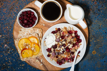 crumble with fresh berries, toast and coffee, top view