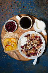 crumble with fresh berries, toast and coffee, vertical top view