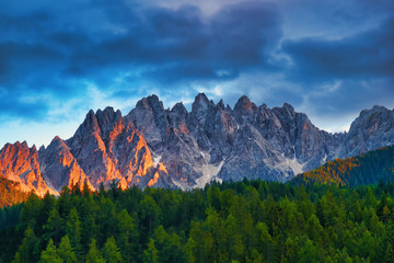 amazing dramatic mountains dolomites peaks at sunset in summer