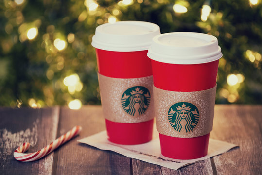 Starbucks popular holiday beverage displayed with candy canes against Christmas tree background on November 24, 2015 in Dallas, Texas.