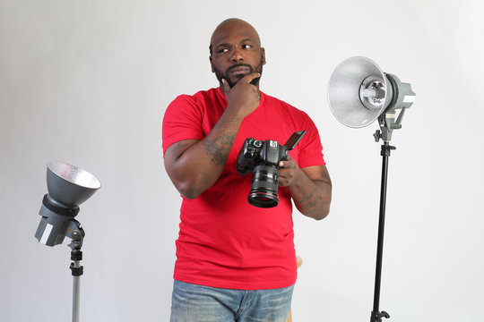 african american photographer thinking about what photos to take