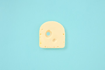 Piece of cheese on blue color background