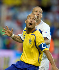 Sweden's Ljungberg and Iceland's Steinsson focus on the ball in their Euro 2008 Group F qualifier soccer match in Stockholm