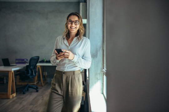 Smiling businesswoman at work in office