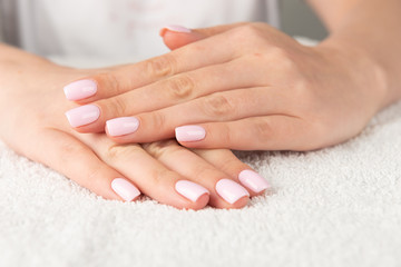 Foto op Canvas Manicure female hand with light pink nail design....