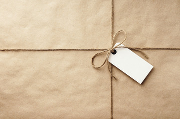 parcel - brown craft paper with twine & white label